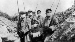 circa 1915: French troops wearing an early form of gas mask in the trenches during the 2nd Battle of Ypres. (Photo by Hulton Archive/Getty Images)