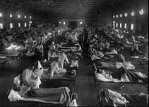 ** FILE ** Influenza victims crowd into an emergency hospital near Fort Riley, Kansas in this 1918 file photo. The 1918 Spanish flu pandemic killed at least 20 million people worldwide. More than five years after the Sept. 11 attacks, the government cannot show how the $5 billion given to public health departments has better prepared the country for a bio terrorism attack or flu pandemic. (AP Photo/National Museum of Health)